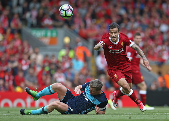 LIVERPOOL, ENGLAND - MAY 21: Adam Clayton of Middlesbrough and Philippe Coutinho of Liverpool in action  during the Premier League match between Liverpool and Middlesbrough at Anfield on May 21, 2017 in Liverpool, England.  (Photo by Jan Kruger/Getty Images)