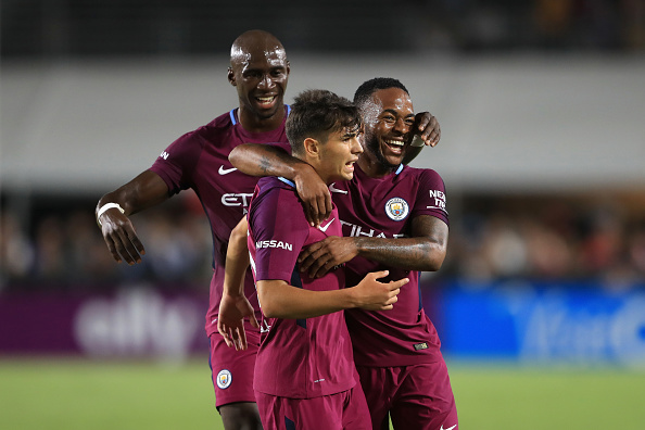 LOS ANGELES, CA - JULY 26:  Eliaquim Mangala #15 and Raheem Sterling #7 congratulate Brahim Diaz #55 of Manchester City after he scored a goal during the second half of the International Champions Cup soccer match at Los Angeles Memorial Coliseum on July 26, 2017 in Los Angeles, California.  (Photo by Sean M. Haffey/Getty Images)