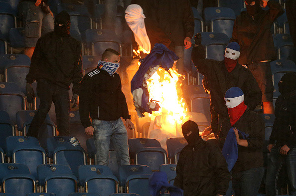 ROSTOCK, GERMANY - AUGUST 14:  Supporters of Rostock set merchandise articles of Berlin on fire during the DFB Cup first round match between FC Hansa Rostock and Hertha BSC at Ostseestadion on August 14, 2017 in Rostock, Germany.  (Photo by Matthias Kern/Bongarts/Getty Images)