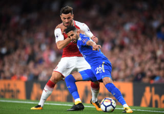 LONDON, ENGLAND - AUGUST 11:  Riyad Mahrez of Leicester City is tackled by Sead Kolasinac of Arsenal during the Premier League match between Arsenal and Leicester City at the Emirates Stadium on August 11, 2017 in London, England.  (Photo by Michael Regan/Getty Images)