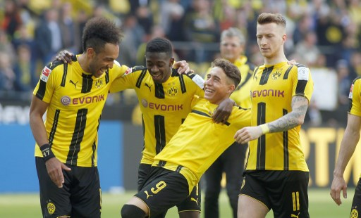 DORTMUND, GERMANY - MAY 6, Pierre-Emerick Aubameyang (L), Ousmane Dembele, Emre Mor and Marco Reus (L-R) celebrate the 2-1 victory against Hoffenheim after the Bundesliga soccer match between Borussia Dortmund and TSG Hoffenheim at the Signal Iduna Park in Dortmund, Germany on May 6, 2017.  Ina Fassbender / Anadolu Agency