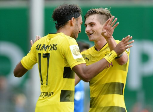 Dortmund's Pierre-Emerick  Aubameyang (L) celebrates with teammate Maximilian Philipp after giving his side a 2:0 lead during the German Soccer Association (DFB)Cup first-round soccer match between 1. FC Rielasingen-Arlen and Borussia Dortmund in the Schwarzwald Stadium in Freiburg, Germany, 12 August 2017.  (EMBARGO CONDITIONS - ATTENTION: The DFB prohibits the utilisation and publication of sequential pictures on the internet and other online media during the match (including half-time). ATTENTION: BLOCKING PERIOD! The DFB permits the further utilisation and publication of the pictures for mobile services (especially MMS) and for DVB-H and DMB only after the end of the match.) Photo: Patrick Seeger/dpa