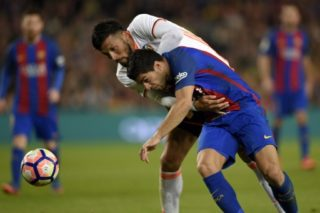 Barcelona's Uruguayan forward Luis Suarez vies with Valencia's Argentinian defender Ezequiel Garay during the Spanish league football match FC Barcelona vs Valencia CF at the Camp Nou stadium in Barcelona on March 19, 2017.