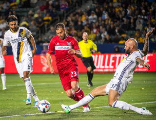 CARSON, CA - MAY 6: Jelle Van Damme #37 of Los Angeles Galaxy clears the ball from Nemanja Nikolic #23 of Chicago Fire but is called for a penalty kick during Los Angeles Galaxy's MLS match against Chicago Fire at the StubHub Center on May 6, 2017 in Carson, California.  The match ended in a 2-2 tie.(Photo by Shaun Clark/Getty Images) *** Local Caption *** Jelle Van Damme; Nemanja Nikolic