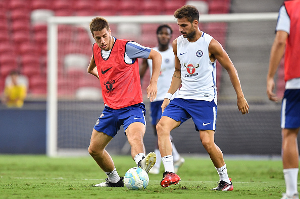 SINGAPORE - JULY 24: Cesc Fabregas #4 and Mario Pasalic of Chelsea FC competes for the ball during a Chelsea FC International Champions Cup training session at National Stadium on July 24, 2017 in Singapore.  (Photo by Thananuwat Srirasant/Getty Images  for ICC)