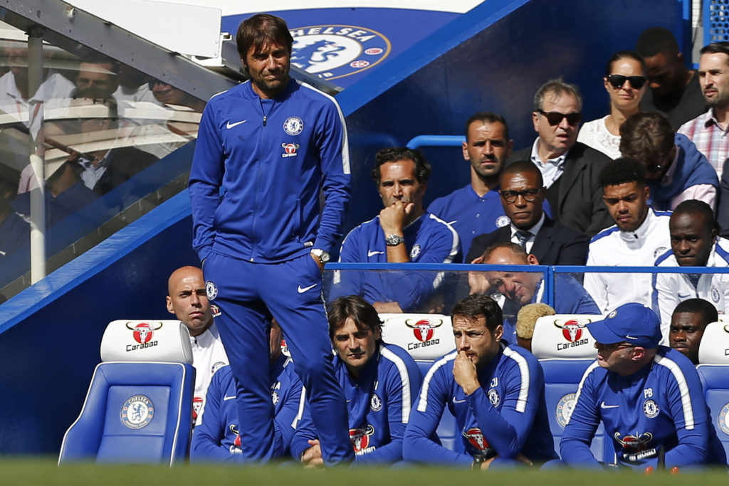 Chelsea's Italian head coach Antonio Conte watches from the touchline after going three down during the English Premier League football match between Chelsea and Burnley at Stamford Bridge in London on August 12, 2017. / AFP PHOTO / Ian KINGTON / RESTRICTED TO EDITORIAL USE. No use with unauthorized audio, video, data, fixture lists, club/league logos or 'live' services. Online in-match use limited to 75 images, no video emulation. No use in betting, games or single club/league/player publications.  /