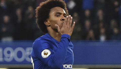 Chelsea's Brazilian midfielder Willian celebrates scoring the opening goal during the English Premier League football match between Chelsea and Crystal Palace at Stamford Bridge in London on March 10, 2018. / AFP PHOTO / Glyn KIRK / RESTRICTED TO EDITORIAL USE. No use with unauthorized audio, video, data, fixture lists, club/league logos or 'live' services. Online in-match use limited to 75 images, no video emulation. No use in betting, games or single club/league/player publications.  /