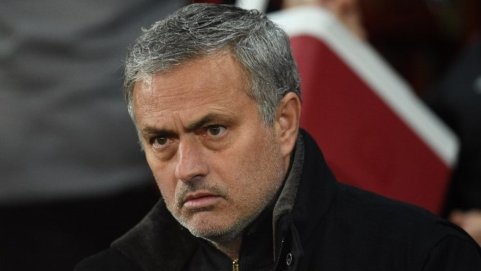 Manchester United's Portuguese manager Jose Mourinho looks on during a last 16 second leg UEFA Champions League football match between Manchester United and Sevilla at Old Trafford in Manchester, northwest England on March 13, 2018. / AFP PHOTO / Oli SCARFF
