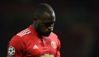Manchester United's Belgian striker Romelu Lukaku reacts after losing a last 16 second leg UEFA Champions League football match between Manchester United and Sevilla at Old Trafford in Manchester, northwest England on March 13, 2018. / AFP PHOTO / Oli SCARFF