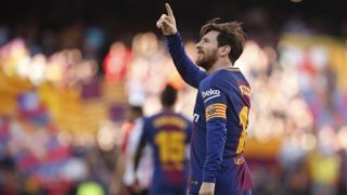 Barcelona's Argentinian forward Lionel Messi celebrates after scoring during the Spanish League football match between FC Barcelona and Athletic Club Bilbao at the Camp Nou stadium in Barcelona on March 18, 2018. / AFP PHOTO / Pau Barrena