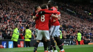 Manchester United's Chilean striker Alexis Sanchez celebrates scoring the team's second goal with  teammates during the English Premier League football match between Manchester United and Swansea at Old Trafford in Manchester, north west England, on March 31, 2018. / AFP PHOTO / Lindsey PARNABY / RESTRICTED TO EDITORIAL USE. No use with unauthorized audio, video, data, fixture lists, club/league logos or 'live' services. Online in-match use limited to 75 images, no video emulation. No use in betting, games or single club/league/player publications.  /
