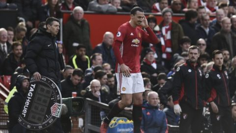Manchester United's Swedish striker Zlatan Ibrahimovic (C) holds his head after clashing with Bournemouth's English defender Tyrone Mings during the English Premier League football match between Manchester United and Bournemouth at Old Trafford in Manchester, north west England, on March 4, 2017. / AFP PHOTO / Oli SCARFF / RESTRICTED TO EDITORIAL USE. No use with unauthorized audio, video, data, fixture lists, club/league logos or 'live' services. Online in-match use limited to 75 images, no video emulation. No use in betting, games or single club/league/player publications.  /