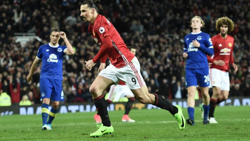 Manchester United's Swedish striker Zlatan Ibrahimovic celebrates scoring his team's first goal from the penalty spot during the English Premier League football match between Manchester United and Everton at Old Trafford in Manchester, north west England, on April 4, 2017. The match ended in a draw at 1-1. / AFP PHOTO / Oli SCARFF / RESTRICTED TO EDITORIAL USE. No use with unauthorized audio, video, data, fixture lists, club/league logos or 'live' services. Online in-match use limited to 75 images, no video emulation. No use in betting, games or single club/league/player publications.  /