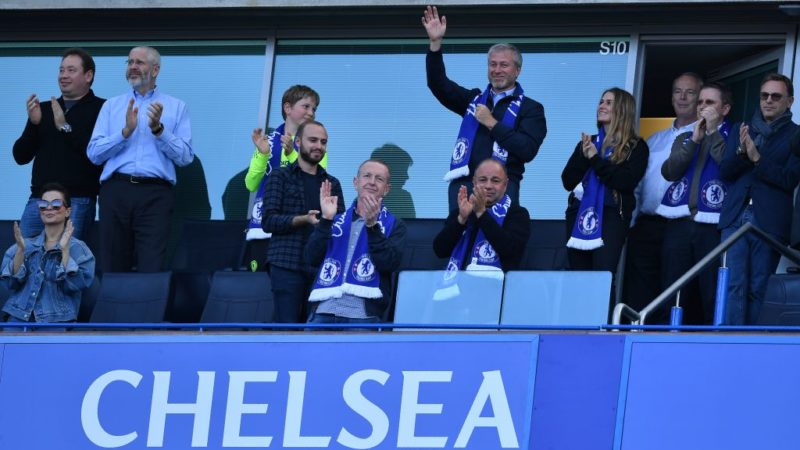 Chelsea's Russian owner Roman Abramovich waves, as players celebrate their league title win at the end of the Premier League football match between Chelsea and Sunderland at Stamford Bridge in London on May 21, 2017. Chelsea's extended victory parade reached a climax with the trophy presentation on May 21, 2017 after being crowned Premier League champions with two games to go.  / AFP PHOTO / Ben STANSALL / RESTRICTED TO EDITORIAL USE. No use with unauthorized audio, video, data, fixture lists, club/league logos or 'live' services. Online in-match use limited to 75 images, no video emulation. No use in betting, games or single club/league/player publications.  /