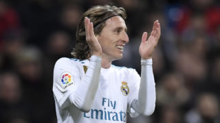 Real Madrid's Croatian midfielder Luka Modric applauds during the Spanish league football match between Real Madrid CF and Real Sociedad at the Santiago Bernabeu stadium in Madrid on February 10, 2018. / AFP PHOTO / GABRIEL BOUYS