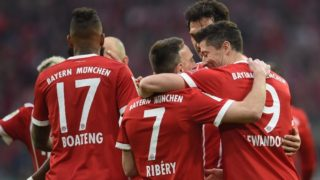 31 March 2018, Germany, Munich: soccer, Bundesliga, Bayern Munich vs Borussia Dortmund, in the Allianz Arena: Bayern Munich's players surrounding Franck Ribery (2nd from right) celebrating Ribery's scoring of the second goal, which was later annulled. Photo: Andreas Gebert/dpa - IMPORTANT NOTICE: Due to the German Football League·s (DFL) accreditation regulations, publication and redistribution online and in online media is limited during the match to fifteen images per match