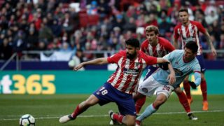 MADRID, SPAIN - MARCH 11: Diego Costa (L) of Atletico Madrid in action against Facundo Roncaglia  of Celta Vigo during  the La Liga soccer match between Atletico Madrid and Celta Vigo at Wanda Metropolitano Stadium in Madrid, Spain on March 11, 2018.  Burak Akbulut / Anadolu Agency