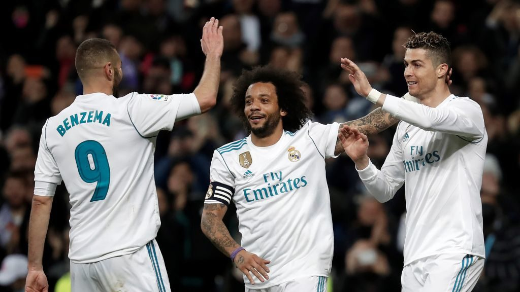 MADRID, SPAIN - MARCH 18: Cristiano Ronaldo of Real Madrid (R) celebrates with Marcelo Vieira and Benzema after scoring a goal during the La Liga soccer match between Real Madrid and Girona at Santiago Bernabeu Stadium in Madrid, Spain on March 18, 2018.  Burak Akbulut / Anadolu Agency