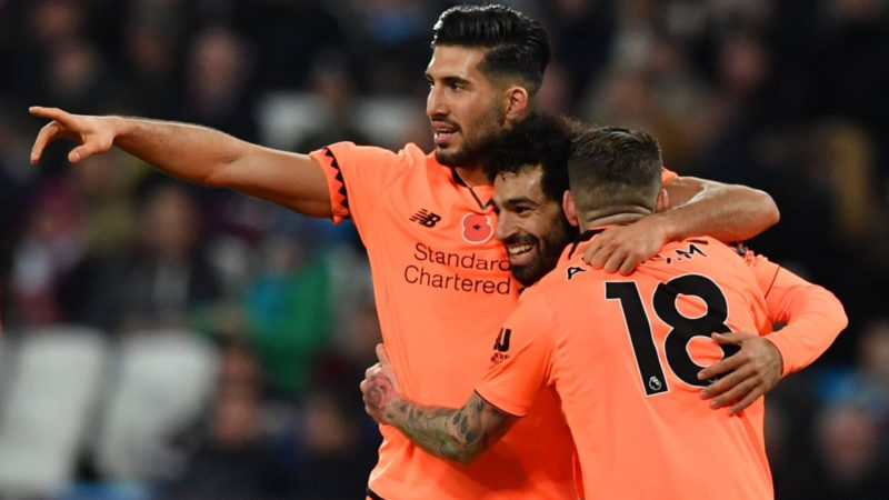 Liverpool's Egyptian midfielder Mohamed Salah (C) celebrates after scoring with Liverpool's German midfielder Emre Can (L) and Liverpool's Spanish defender Alberto Moreno during the English Premier League football match between West Ham United and Liverpool at The London Stadium, in east London on November 4, 2017. / AFP PHOTO / Ben STANSALL / RESTRICTED TO EDITORIAL USE. No use with unauthorized audio, video, data, fixture lists, club/league logos or 'live' services. Online in-match use limited to 75 images, no video emulation. No use in betting, games or single club/league/player publications.  /