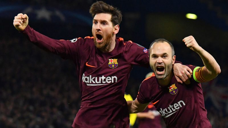 Barcelona's Argentinian striker Lionel Messi (L) celebrates with Barcelona's Spanish midfielder Andres Iniesta (R) after scoring their first goal during the first leg of the UEFA Champions League round of 16 football match between Chelsea and Barcelona at Stamford Bridge stadium in London on February 20, 2018. / AFP PHOTO / Ben STANSALL