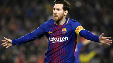 Barcelona's Argentinian forward Lionel Messi celebrates scoring his team's third goal during the UEFA Champions League round of sixteen second leg  football match between FC Barcelona and Chelsea FC at the Camp Nou stadium in Barcelona on March 14, 2018. / AFP PHOTO / LLUIS GENE