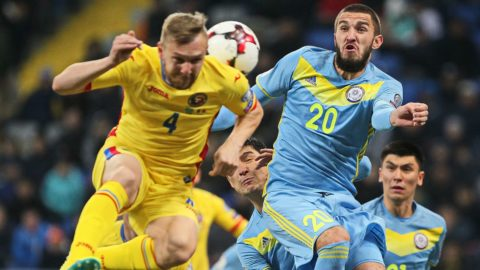 Romania's Cosmin Moti vies for the ball with Kazakhstan's Sergei Khizhnichenko during the WC 2018 football qualification match between Kazakhstan and Romania in Astana on October 11, 2016.  / AFP PHOTO / STANISLAV FILIPPOV