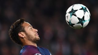 """(FILES) In this file photo taken on October 31, 2017 Paris Saint-Germain's Brazilian forward Neymar controls the ball  during the UEFA Champions League Group B football match between Paris Saint-Germain (PSG) and Anderlecht (RSCA), at the Parc des Princes stadium in Paris. Neymar, recovering in Brazil after his right foot injury, will return """"in two, three weeks"""" to Paris, said PSG coach Unai Emery, on March 30, 2018 on the eve of the final of France's Coupe de la Ligue. / AFP PHOTO / FRANCK FIFE"""