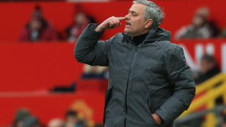 Manchester United's Portuguese manager Jose Mourinho gestures during the English Premier League football match between Manchester United and Swansea at Old Trafford in Manchester, north west England, on March 31, 2018. / AFP PHOTO / Lindsey PARNABY / RESTRICTED TO EDITORIAL USE. No use with unauthorized audio, video, data, fixture lists, club/league logos or 'live' services. Online in-match use limited to 75 images, no video emulation. No use in betting, games or single club/league/player publications.  /