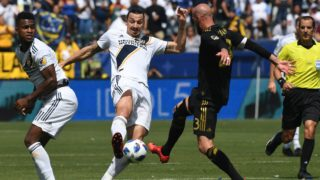 Zlatan Ibrahimovic from LA Galaxy (C) is tackled by Laurent Ciman (R)  of LAFC during their Major League Soccer (MLS) game at the StarHub Center in Los Angeles, California, on March 31, 2018. LA Galaxy went on to win 4-3 with two goals from Ibrahimovic.    / AFP PHOTO / Mark RALSTON