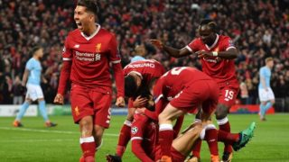 Liverpool players celebrates Liverpool's Egyptian midfielder Mohamed Salah (C) goal during the UEFA Champions League first leg quarter-final football match between Liverpool and Manchester City, at Anfield stadium in Liverpool, north west England on April 4, 2018. / AFP PHOTO / Anthony Devlin