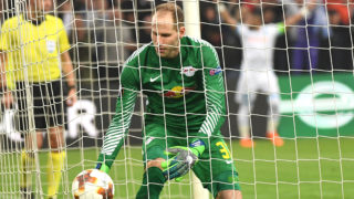 Leipzig's Hungarian goalkeeper Peter Gulacsi takes the ball in his net during the Europa League quarter final second leg football match Olympique de Marseille (OM) vs RB Leipzig at the Velodrome stadium in Marseille, on April 12, 2018.    / AFP PHOTO / BORIS HORVAT