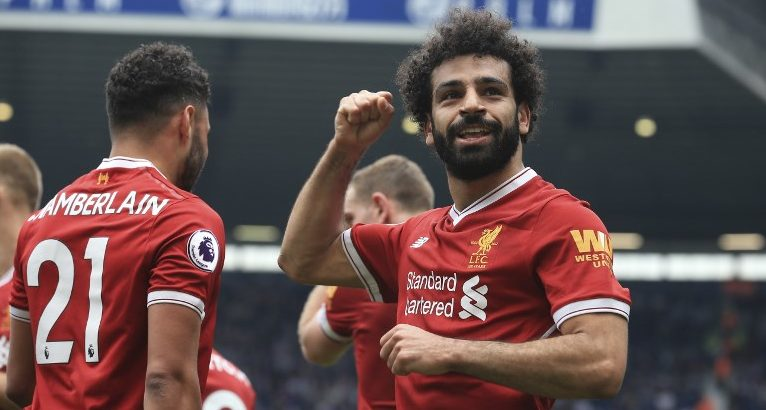 Liverpool's Egyptian midfielder Mohamed Salah celebrates scoring their second goal during the English Premier League football match between West Bromwich Albion and Liverpool at The Hawthorns stadium in West Bromwich, central England, on April 21, 2018.  / AFP PHOTO / Lindsey PARNABY / RESTRICTED TO EDITORIAL USE. No use with unauthorized audio, video, data, fixture lists, club/league logos or 'live' services. Online in-match use limited to 75 images, no video emulation. No use in betting, games or single club/league/player publications.  /