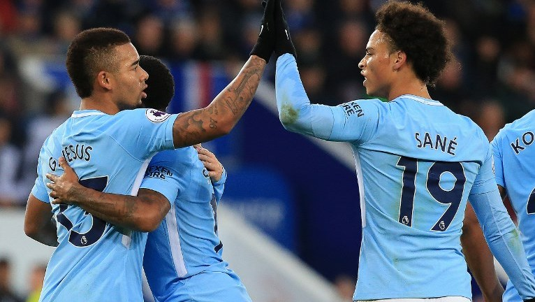 Manchester City's Brazilian striker Gabriel Jesus (L) celebrates scoring the opening goal with Manchester City's German midfielder Leroy Sane during the English Premier League football match between Leicester City and Manchester City at King Power Stadium in Leicester, central England on November 18, 2017. / AFP PHOTO / Lindsey PARNABY / RESTRICTED TO EDITORIAL USE. No use with unauthorized audio, video, data, fixture lists, club/league logos or 'live' services. Online in-match use limited to 75 images, no video emulation. No use in betting, games or single club/league/player publications.  /