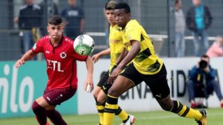 FILE -File picture dated 19 August 2017 showing Youssoufa Moukoko (R) from Borussia Dortmund's U17 in action during the 6:1 win over Viktoria Cologne in Dortmund, Germany. According to his birth certificate he is only 12 years old but already the attraction among Dortmund's U17 squad. The young player has astounded the soccer experts with his confidence while shooting on target. After only three games the German-Cameroonian already leads the Bundlesliga West B-Juniors' list of top scorers with 8 goals. Photo: Peter Ludewig/dpa