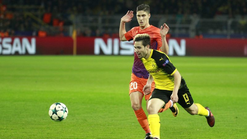 DORTMUND, GERMANY - NOVEMBER 01: Raphael Guerreiro (front) of Borussia Dortmund in action against Roland Sallai (rear) of APOEL Nicosia during the UEFA Champions League Group H soccer match between Borussia Dortmund and APOEL Nicosia at Signal-Iduna Park in Dortmund, Germany on November 01, 2017. Leon Kuegeler / Anadolu Agency