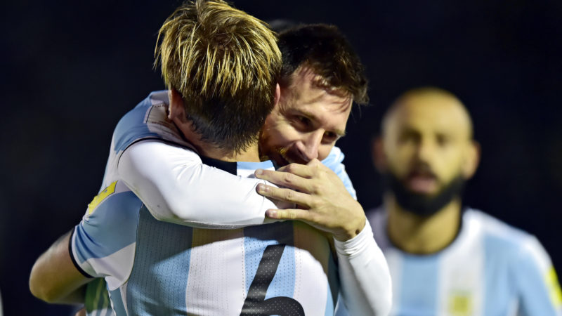 Argentina's Lionel Messi celebrates with teammate Lucas Biglia after scoring against Ecuador during their 2018 World Cup qualifier football match in Quito, on October 10, 2017. / AFP PHOTO / Rodrigo BUENDIA