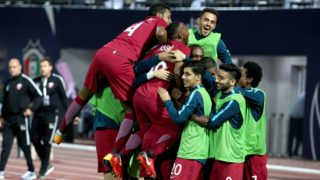 Members of Qatar's national football team celebrate after scoring a goal against Yemen during their 2017 Gulf Cup of Nations football match at the Sheikh Jaber al-Ahmad Stadium in Kuwait City on December 23, 2017. / AFP PHOTO / Yasser Al-Zayyat