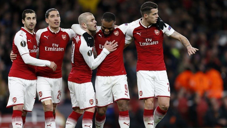 Arsenal's French striker Alexandre Lacazette (2nd R) celebrates with (L-R) Arsenal's Armenian midfielder Henrikh Mkhitaryan, Arsenal's Spanish defender Hector Bellerin, Arsenal's English midfielder Jack Wilshere and Arsenal's Swiss midfielder Granit Xhaka after scoring their fourth goal during the UEFA Europa League first leg quarter-final football match  between Arsenal and CSKA Moscow at the Emirates Stadium in London on April 5, 2018.  / AFP PHOTO / IKIMAGES / Ian KINGTON