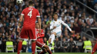 Real Madrid's Portuguese forward Cristiano Ronaldo (R) shoots the ball during the UEFA Champions League semi-final second-leg football match Real Madrid CF vs FC Bayern Munich in Madrid, Spain, on May 1, 2018. / AFP PHOTO / GABRIEL BOUYS
