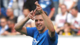 Hoffenheim's Hungarian forward Adam Szalai celebrates after scoring his team's second goal during the German first division Bundesliga football match TSG 1899 Hoffenheim vs Borussia Dortmund in Sinsheim, southern Germany, on May 12, 2018. / AFP PHOTO / Amelie QUERFURTH / RESTRICTIONS: DURING MATCH TIME: DFL RULES TO LIMIT THE ONLINE USAGE TO 15 PICTURES PER MATCH AND FORBID IMAGE SEQUENCES TO SIMULATE VIDEO. == RESTRICTED TO EDITORIAL USE == FOR FURTHER QUERIES PLEASE CONTACT DFL DIRECTLY AT + 49 69 650050