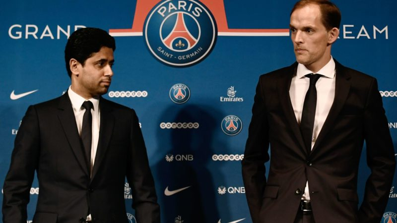 French Ligue 1 football club Paris Saint-Germain's newly appointed coach German Thomas Tuchel (R) stands with club's president Nasser Al-Khelaifi at the end of a press conference to officially present him as the club's new recruit on May 20, 2018 at the Parc des Princes stadium in Paris.  / AFP PHOTO / Philippe LOPEZ