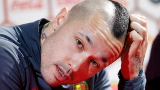(FILES) In this file photo taken on March 20, 2017 Belgium's Radja Nainggolan speaks during a press conference after a training session of Belgian national soccer team Red Devils at the Belgian Football Center in Tubize.  Belgium have left midfield creator Radja Nainggolan out of their World Cup squad, coach Roberto Martinez said on May 21, 2018. The absence of Nainggolan, who scored twice for Roma in the second league of the Champions League semi-final against Liverpool this month, was the biggest surprise in the 28-player list that will be reduced to 23 before the tournament. / AFP PHOTO / Belga / BRUNO FAHY / Belgium OUT