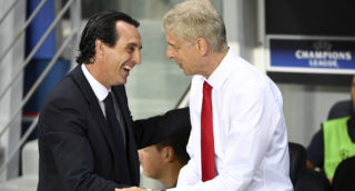 """(FILES) In this file photo taken on September 13, 2016, Paris Saint-Germain's Spanish head coach Unai Emery (L) shakes hands with Arsenal's French manager Arsene Wenger during the UEFA Champions League Group A football match between Paris-Saint-Germain and Arsenal FC, at the Parc des Princes stadium in Paris.  Unai Emery has been appointed as the new manager of Arsenal, the club announced on May 23, 2018. """"Unai Emery is to become our new head coach,"""" said a statement on the club's website. """"He joins the club after completing a two-year spell at Paris Saint-Germain, where he recently landed the treble of Ligue 1, Coupe de France and the Coupe de la Ligue."""" / AFP PHOTO / FRANCK FIFE"""