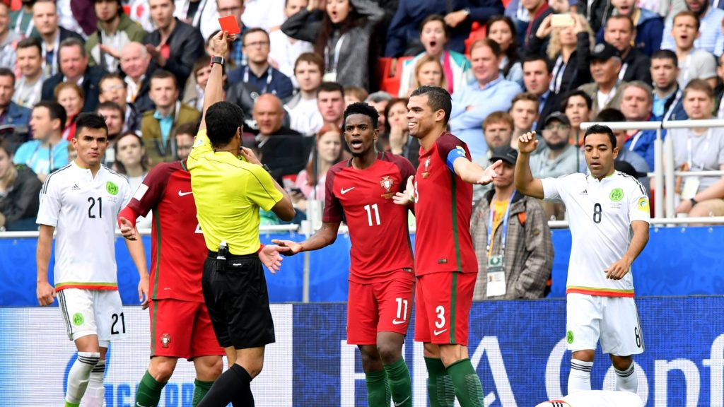 Portugal's defender Nelson Semedo (C) reacts as he receives a red card from Saudi referee Fahad Al Mirdasi (C-L) during the 2017 FIFA Confederations Cup third place football match between Portugal and Mexico at the Spartak Stadium in Moscow on July 2, 2017. / AFP PHOTO / Yuri KADOBNOV