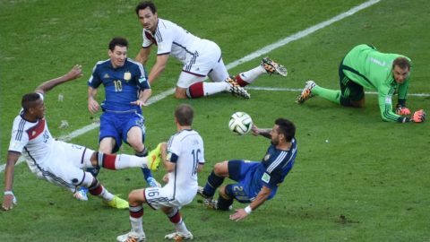 Defender Jerome Boateng (L) of Germany kicks the ball away while German goalkeeper Manuel Neuer (R), Lionel Messi (C), Ezequiel Lavezzi of Argentina, Mats Hummels and Philipp Lahm watch the scene during the FIFA World Cup 2014 final soccer match between Germany and Argentina at the Estadio do Maracana in Rio de Janeiro, Brazil, 13 July 2014 while Bastian Schweinsteiger and Mats Hummels of Germany watcsh the scene. Photo:Thomas Eisenhuth/dpa (RESTRICTIONS APPLY: Editorial Use Only, not used in association with any commercial entity - Images must not be used in any form of alert service or push service of any kind including via mobile alert services, downloads to mobile devices or MMS messaging - Images must appear as still images and must not emulate match action video footage - No alteration is made to, and no text or image is superimposed over, any published image which: (a) intentionally obscures or removes a sponsor identification image; or (b) adds or overlays the commercial identification of any third party which is not officially associated with the FIFA World Cup) EDITORIAL USE ONLY