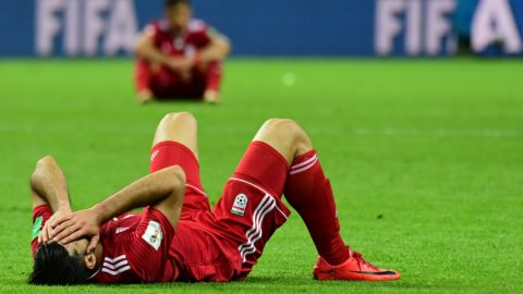Iran's forward Mehdi Taremi reacts after defeat during the Russia 2018 World Cup Group B football match between Iran and Spain at the Kazan Arena in Kazan on June 20, 2018. / AFP PHOTO / Luis Acosta / RESTRICTED TO EDITORIAL USE - NO MOBILE PUSH ALERTS/DOWNLOADS