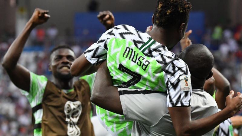 Nigeria's forward Ahmed Musa and teammates celebrate their victory at the end of the Russia 2018 World Cup Group D football match between Nigeria and Iceland at the Volgograd Arena in Volgograd on June 22, 2018. / AFP PHOTO / Mark RALSTON / RESTRICTED TO EDITORIAL USE - NO MOBILE PUSH ALERTS/DOWNLOADS