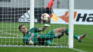 FC Zorya Luhansk's goalkeeper Andriy Lunin fails to stop the ball during the UEFA Europa League, Group J football match FC Zorya Luhansk and Hertha BSC Berlin at the Arena Lviv stadium in Lviv on October 19, 2017.  / AFP PHOTO / SERGEI SUPINSKY