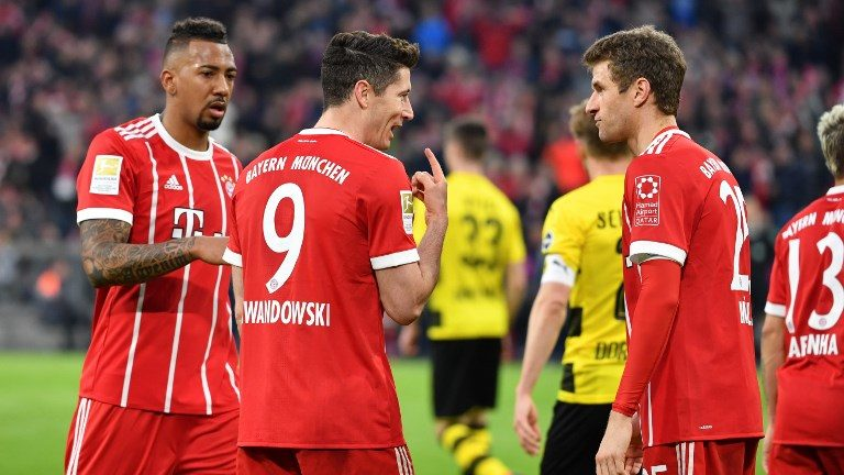 v.re:Thomas MUELLER (MULLER,FC Bayern Munich), Robert LEWANDOWSKI  (FC Bayern Munich),Jerome BOATENG (FC Bayern Munich), Aktion, gesture. Fussball 1. Bundesliga. 28,matchday,matchday28, FC Bayern Munich (M)-Borussia Dortmund (DO) 6-0, am 31.03.2018 in Muenchen/Germany, A L L I A N Z   A R E N A. |usage worldwide