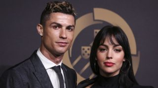 """Portugal's forward Cristiano Ronaldo (L) accompanied by Georgina Rodriguez  pose on arrival at """"Quinas de Ouro"""" ceremony held at Pavilhao Carlos Lopes in Lisbon, on March 19, 2018.  NURPHOTO/CARLOS COSTA.  (Photo by Carlos Costa/NurPhoto)"""